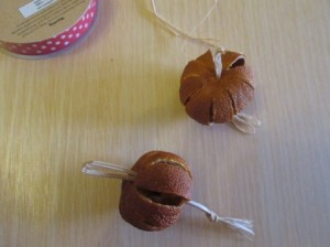 Dried satsumas threaded onto raffia
