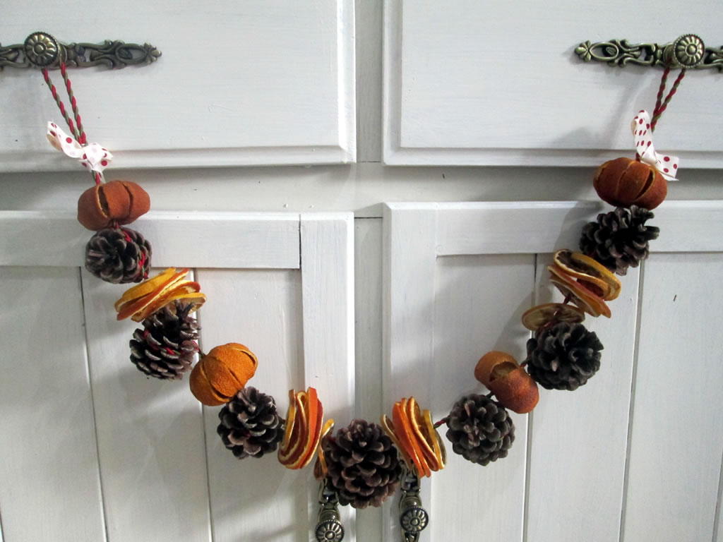 pine cone garland using dried fruit for christmas decorations