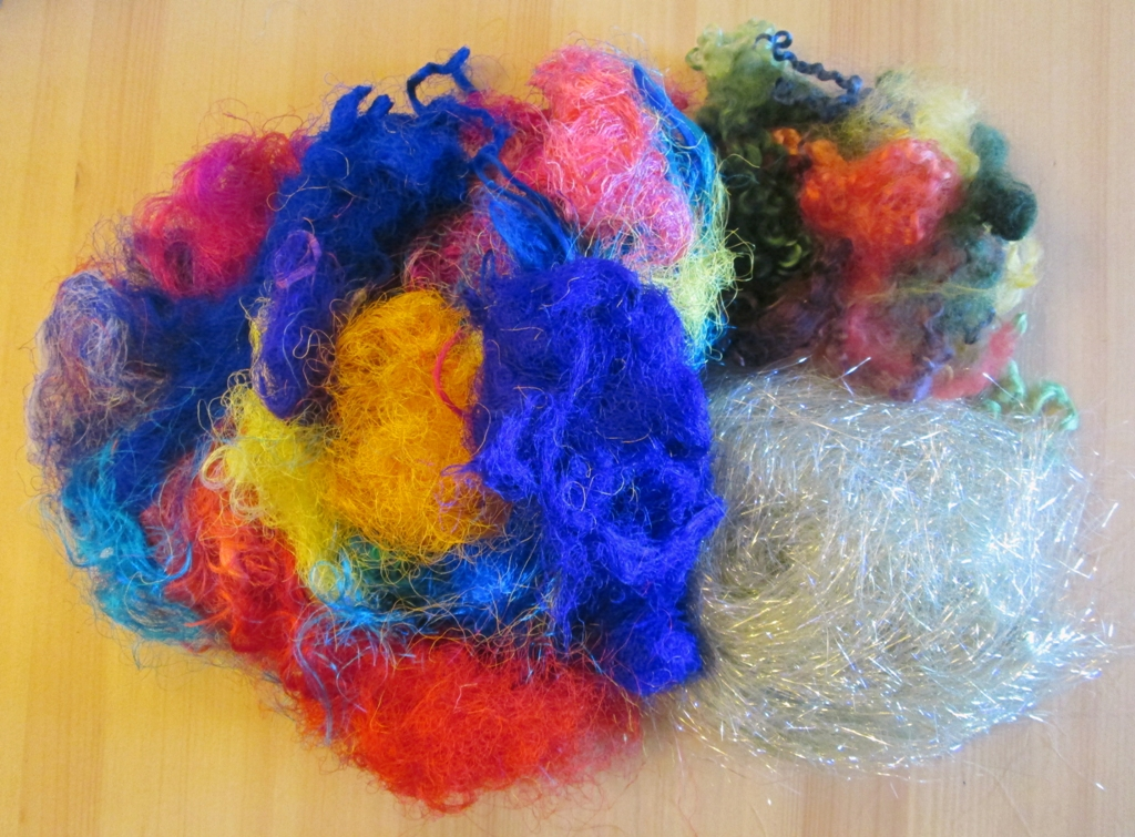 adding fibres to handmade felt