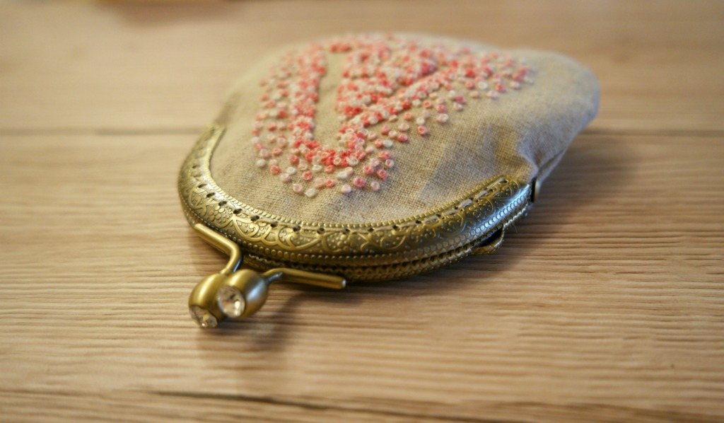 negative space embroidery clasp purse