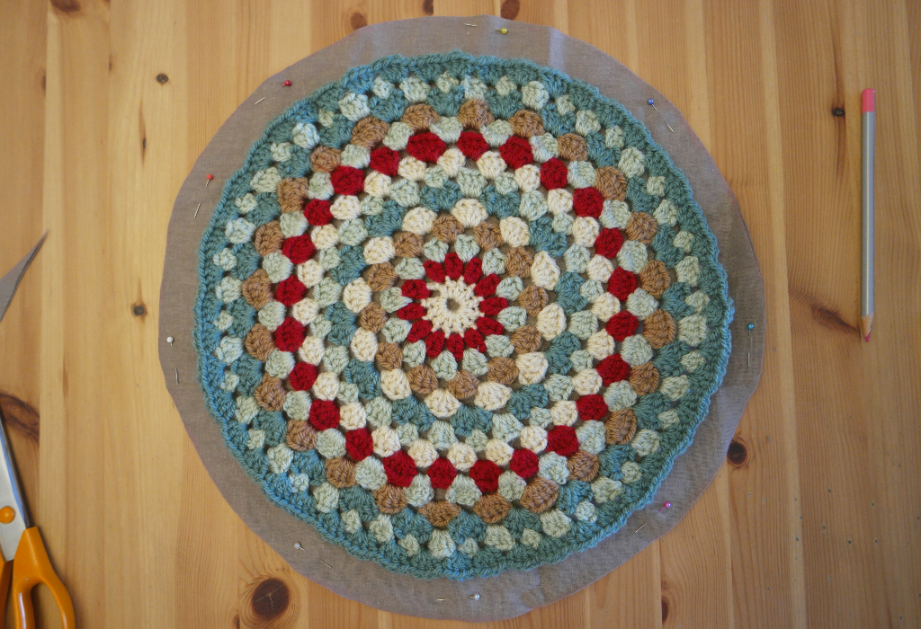crocheted cushion cover